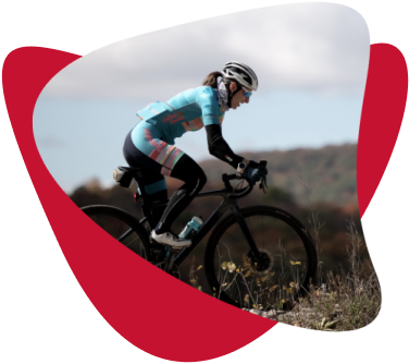 Lea Davison wearing light blue cycling suit and helmet, racing on a bike.